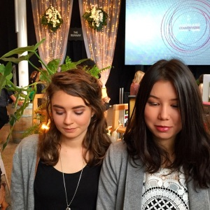 Girls get their mineral makeup applied at Eco Boutique
